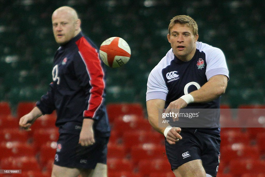England player Tom Youngs (R) passes the ball during a training session at the Millennium Stadium in Cardiff on March 15, 2013 on the eve of their final 6 Nations international rugby union match against Wales.