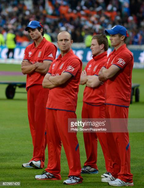 England players Alastair Cook Jonathan Trott Eoin Morgan and Chris Woakes wait for the presentation ceremony after India won the ICC Champions Trophy...
