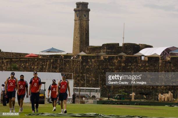 England players Alastair Cook Monty Panesar Stuart Broad Ravi Bopara and James Anderson walk across the pitch on their way back from an indoor nets...