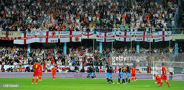 England players and fans celebrate Darren Bent's goal during the UEFA EURO 2012 group G qualifier match between Montenegro and England at the Gradski...