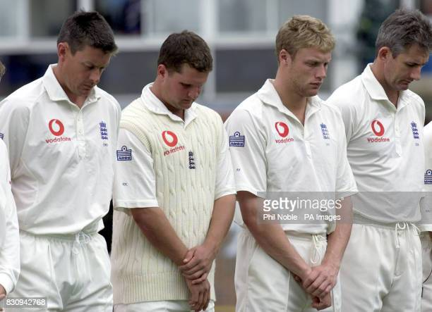England players Ashley Giles Robert Key Andy Flintoff and Andy Cadick bow their heads during a minute's silence for murdered Holly Wells and Jessica...