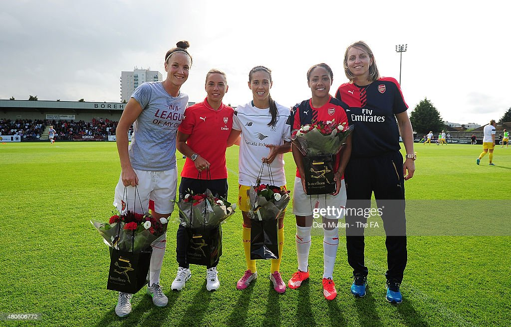 England players Casey Stoney of Arsenal Jordan Nobbs of Arsenal Fara Williams of Liverpool and Alex Scott of Arsenal are presented with a bouquet of...