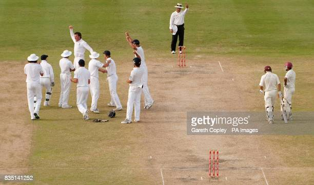 England players celebrate after West Indies' Brendon Nash is given out LBW from Graeme Swann after a referral during the fourth test at Kensington...