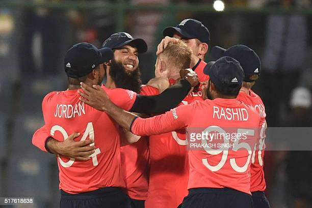England players celebrate after winning the World T20 cricket tournament match between England and Sri Lanka at Feroz Shah Kotla cricket ground in...