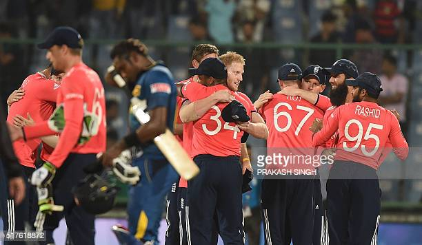England players celebrate after winning the World T20 cricket tournament match between England and Sri Lanka at the Feroz Shah Kotla cricket ground...
