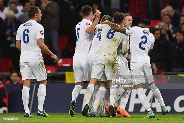 England players celebrate as Danny Welbeck of England scores their second goal during the EURO 2016 Qualifier Group E match between England and...