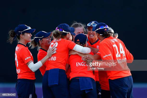 England players celebrate as Elyse Villani of Australia is caught and bowled by Anya Shrubsole of England during the 1st Natwest T20 of the Women's...