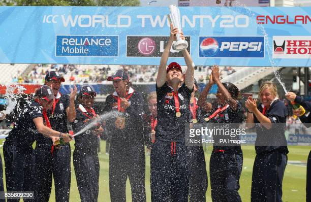 England players celebrate as England captain Charlotte Edwards lifts the ICC World Twenty20 Trophy after the Final of the Womens ICC World Twenty20...