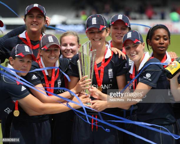 England players celebrate as England captain Charlotte Edwards lifts the ICC World Twenty20 Trophy after the Final of the Women's ICC World Twenty20...