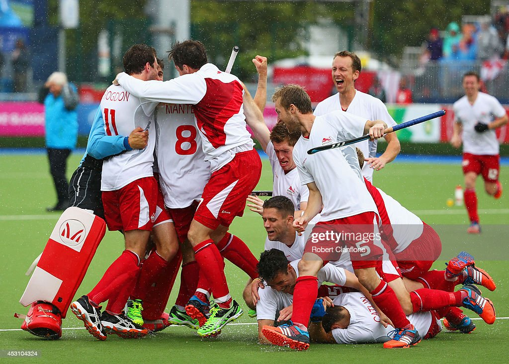 England players celebrate as they win bronze after a shoot out in the bronze medal match between New Zealand and England at Glasgow National Hockey Centre during day eleven of the Glasgow 2014 Commonwealth Games on August 3, 2014 in Glasgow, United Kingdom.