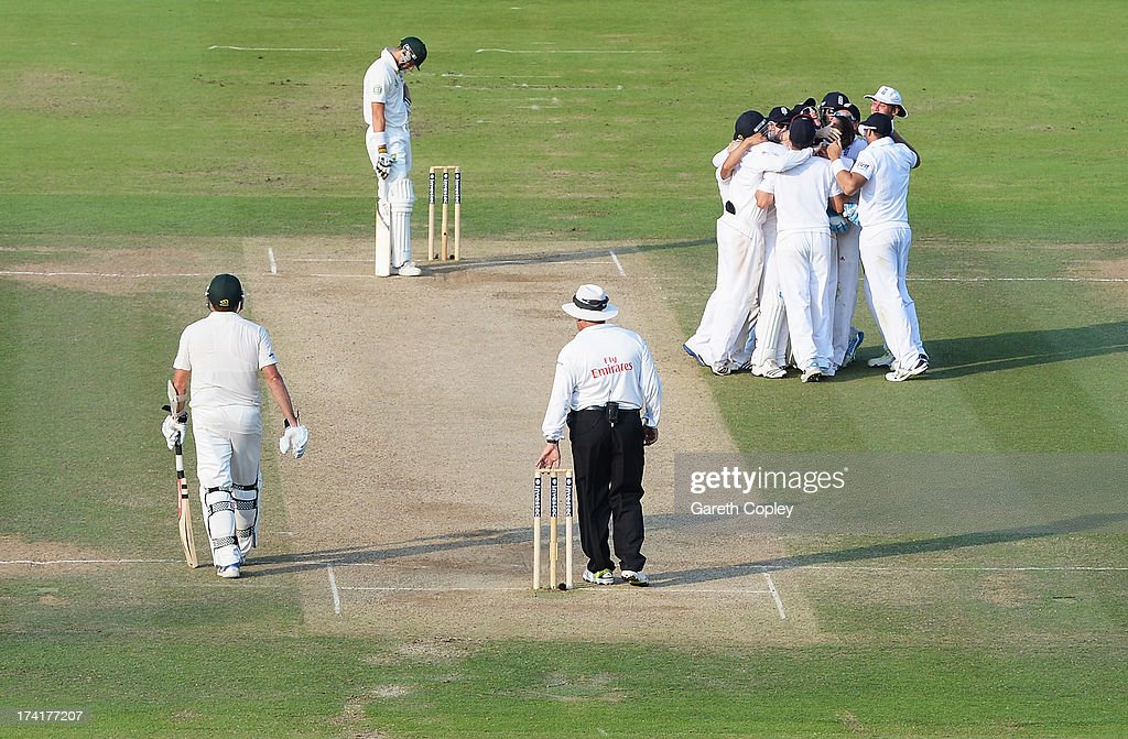 England players celebrate Graeme Swann's final wicket of <a gi-track='captionPersonalityLinkClicked' href=/galleries/search?phrase=James+Pattinson&family=editorial&specificpeople=4884816 ng-click='$event.stopPropagation()'>James Pattinson</a> of Australia during day four of the 2nd Investec Ashes Test match between England and Australia at Lord's Cricket Ground on July 21, 2013 in London, England.