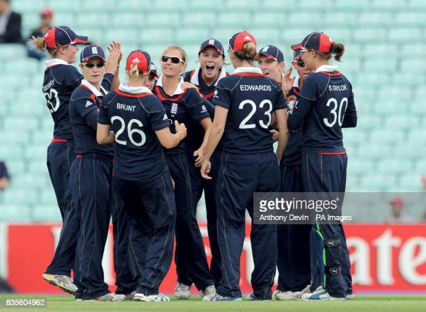 England players celebrate taking the wicket of Australia's Leah Poulton during the ICC Women's World Twenty20 Semi Final at The Oval London