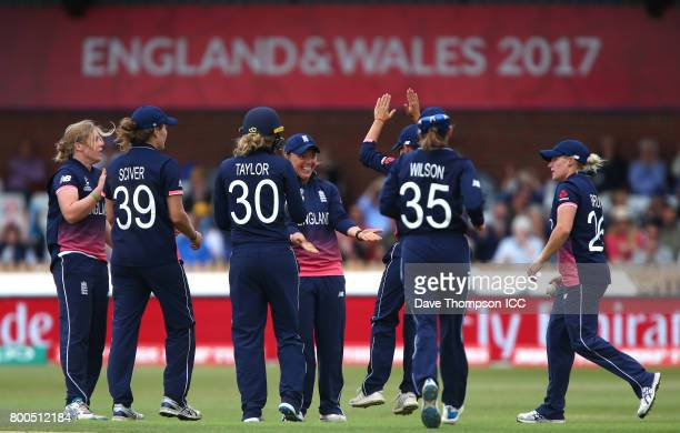 England players celebrate taking the wicket of Smriti Mandhana of India during the ICC Women's World Cup match between England and India at The 3aaa...