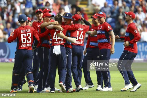 England players celebrate taking the wicket of South Africa's AB de Villiers during the third Twenty20 international cricket match between England...