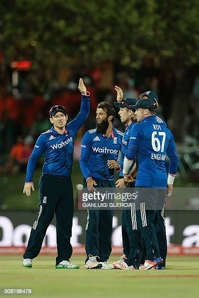 England players celebrate the dismissal of South African batsman Rilee Rossouw during the first One Day International cricket match between England...