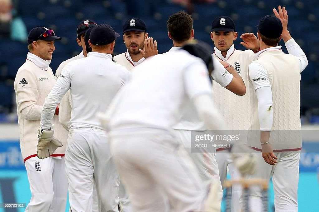 England players celebrate the wicket of Sri Lanka's Milinda Siriwardana (not pictured) off a catch by England's Alex Hales (2nd R) for 35 runs on the fourth day of the second test cricket match between England and Sri Lanka at the Riverside in Chester-le-Street, north east England, on May 30, 2016. / AFP / SCOTT