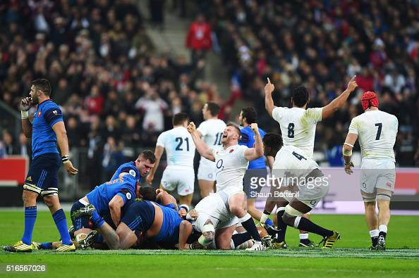 England players celebrate winning the Grand Slam as the final whistle blows on their 3121 victory during the RBS Six Nations match between France and...