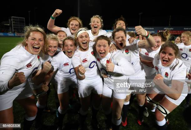 England players celebrate winning the Grand Slam following the final whistle during the Women's Six Nations match between Ireland and England at...