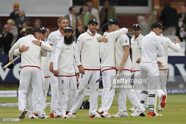 England players congratulate each other after England win the match by 124 runs on the fifth day of the first cricket Test match between England and...