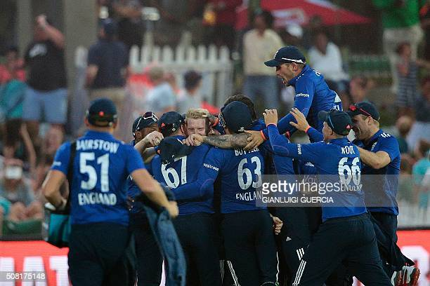 England players congratulate fielder Ben Stokes after catching out South African batsman AB de Villiers during the first One Day International match...