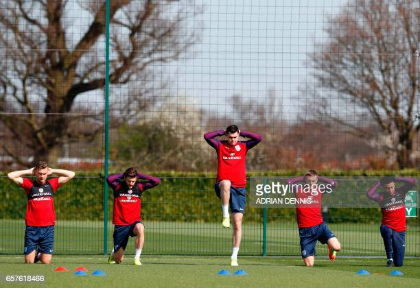 England players defender Ben Gibson midfielder Adam Lallana defender Michael Keane striker Jamie Vardy and midfielder Jesse Lingard stretch during a...