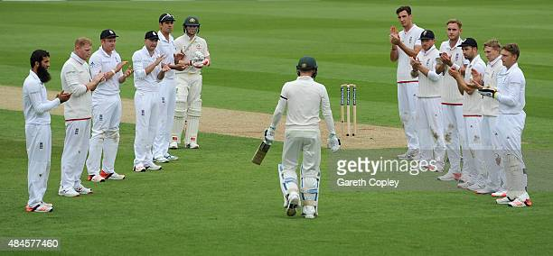 England players form a guard of honour as Australian captain Michael Clarke walks out to bat in his final test during day one of the 5th Investec...