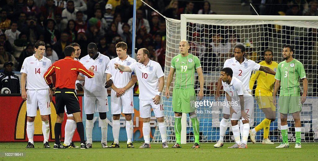 England players form a wall before an Algerian free kick during the 2010 FIFA World Cup South Africa Group C match between England and Algeria at Green Point Stadium on June 18, 2010 in Cape Town, South Africa. <a gi-track='captionPersonalityLinkClicked' href=/galleries/search?phrase=Wayne+Rooney&family=editorial&specificpeople=157598 ng-click='$event.stopPropagation()'>Wayne Rooney</a> of England (10) makes a point to the referee Ravshan Irmatov. The match was drawn 0-0.