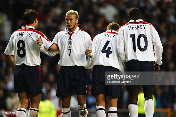 England players Frank Lampard David Beckham Nicky Butt and Emile Heskey line up to defend a freekick during the International Friendly match between...