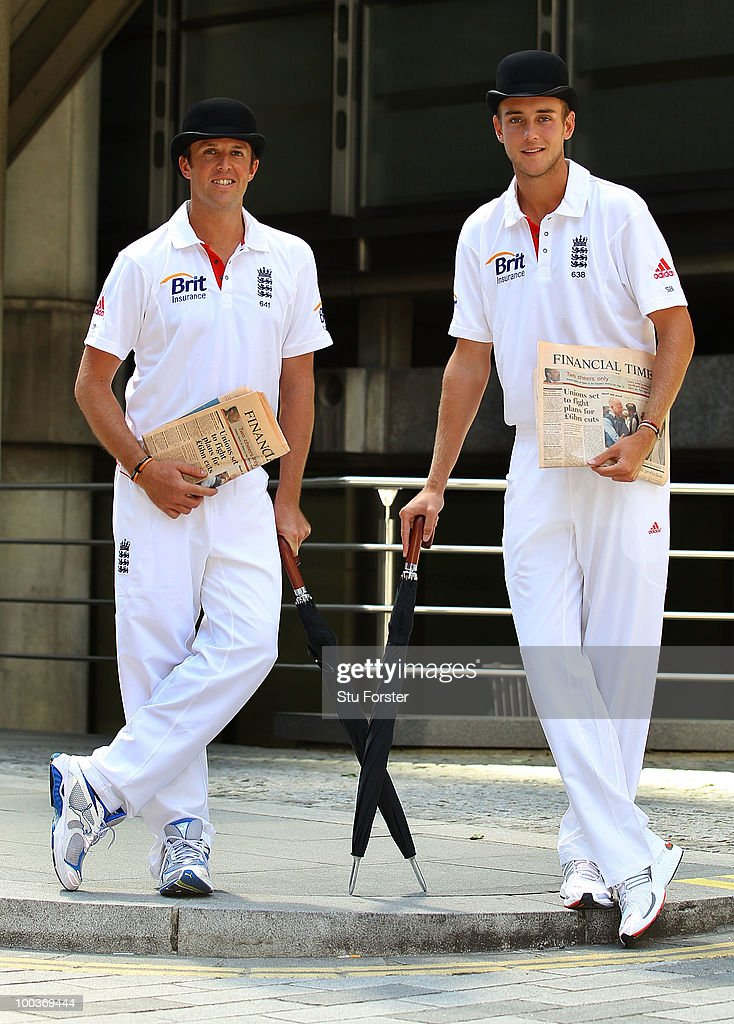 England players Graeme Swann and Stuart Broad (R) catch up on the latest financial news during a visit to Lloyds of London as guests of Brit Insurance on May 24, 2010 in London, England.