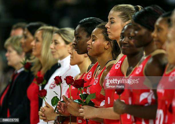 England players hold roses during the National Anthems during the International Test Match between New Zealand and England on August 27 2016 at...