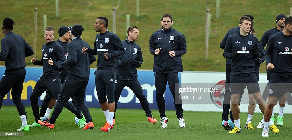 England players including Frank Lampard (C) take part in a training session at the St George's Park training complex, near Burton-upon-Trent, central England on March 19, 2013 ahead of their 2014 World Cup qualifier football match against San Marino on March 22. AFP PHOTO / PAUL ELLIS NOT FOR MARKETING OR ADVERTISING USE / RESTRICTED TO EDITORIAL USE