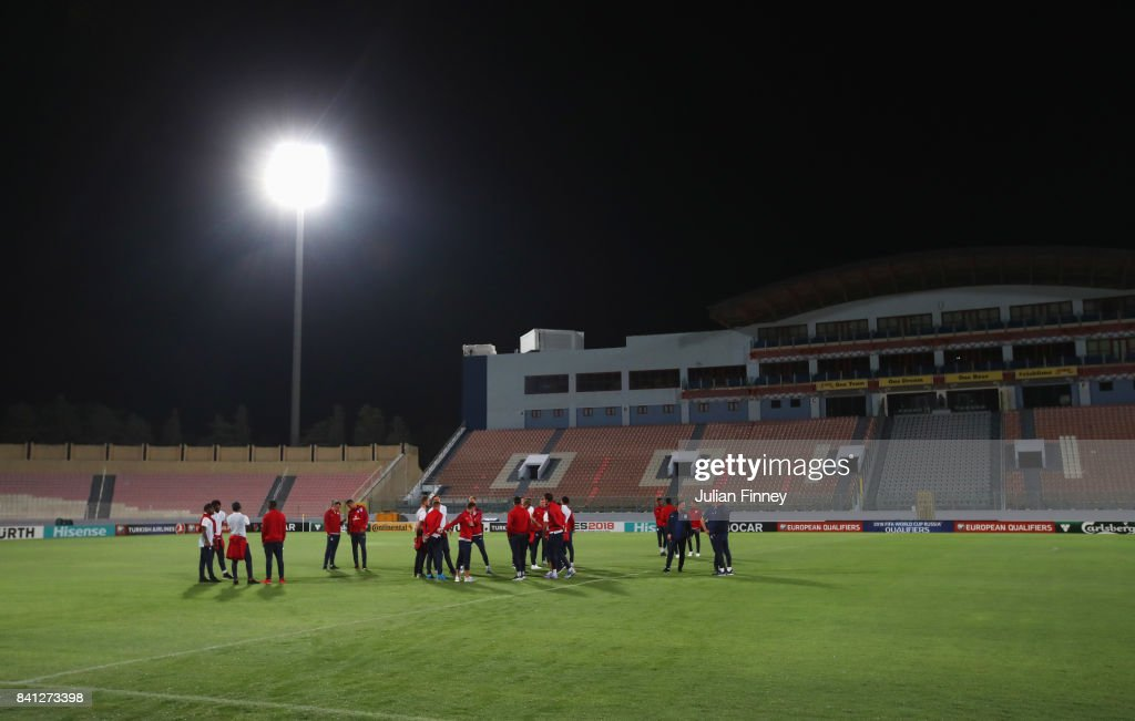 England players inspect the pitch on the eve of the World Cup qualifying match against Malta at Ta'Qali National Stadium on August 31, 2017 in Valletta, Malta.