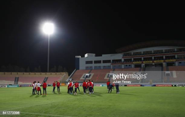 England players inspect the pitch on the eve of the World Cup qualifying match against Malta at Ta'Qali National Stadium on August 31 2017 in...