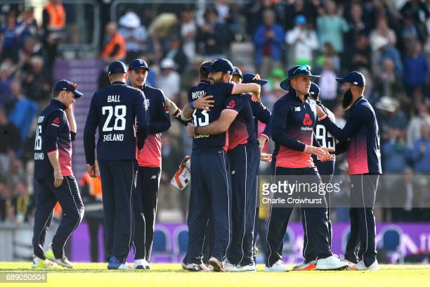 England players Liam Plunkett and Mark Wood celebrate the teams win during the Royal London ODI match between England and South Africa at The Ageas...