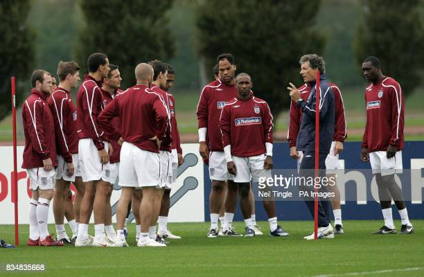 England players listen to Franco Baldini during a training session at London Colney Hertfordshire