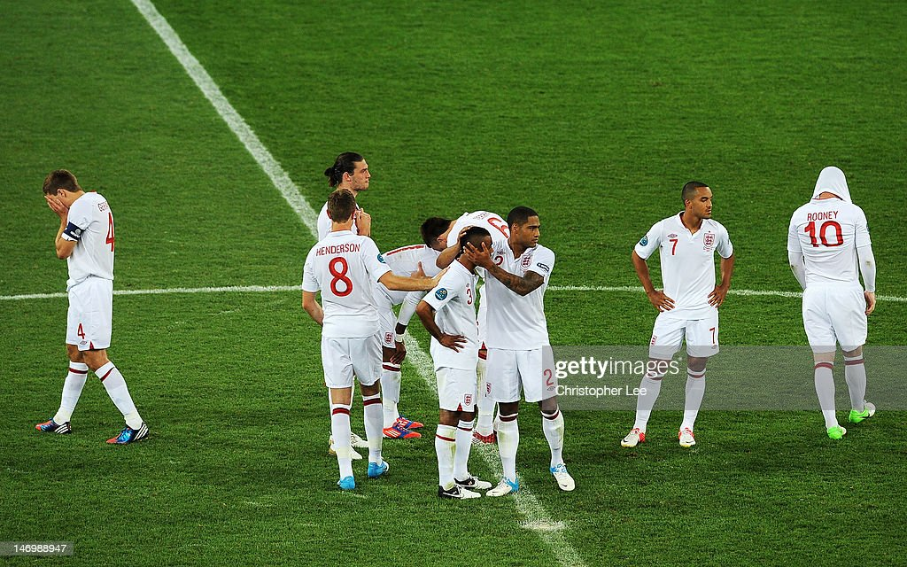 England players look dejected after the UEFA EURO 2012 quarter final match between England and Italy at The Olympic Stadium on June 24, 2012 in Kiev, Ukraine.