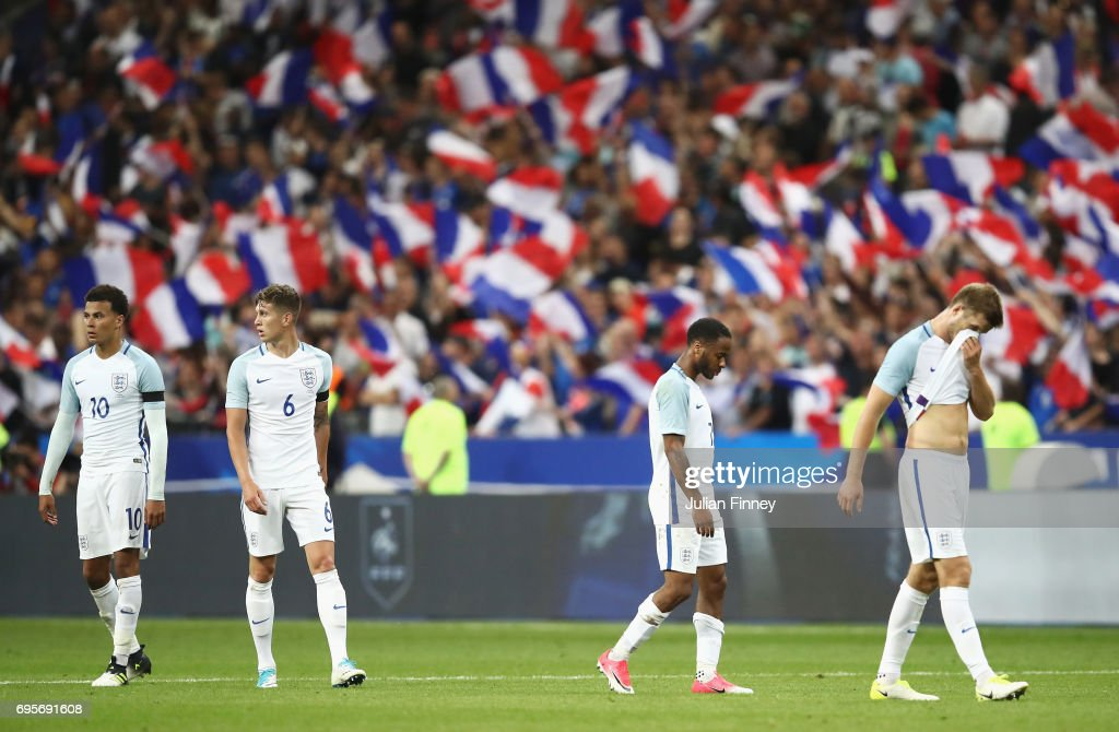 England players look dejected in defeat after the International Friendly match between France and England at Stade de France on June 13, 2017 in Paris, France.