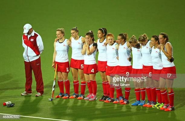 England players look dejected in the Women's Gold Medal Match against Australia at Glasgow National Hockey Centre during day ten of the Glasgow 2014...