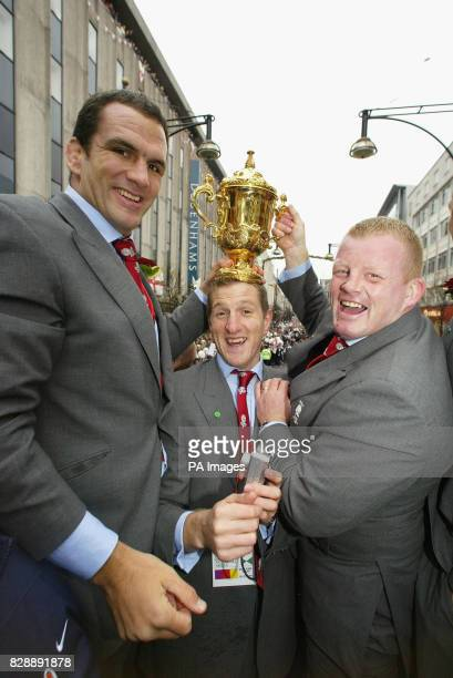 England players Martin Johnson Will Greenwood and Dorian West hold the Webb Ellis Cup during the England Rugby World Cup team victory parade in...