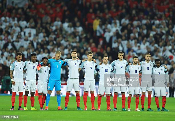 England players observe a silence in remembrance of Armistice Day prior to the FIFA 2018 World Cup qualifying match between England and Scotland at...