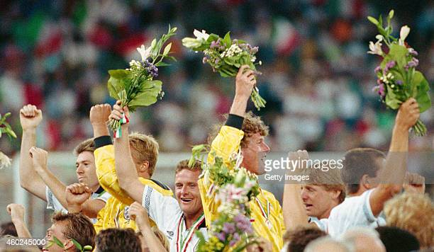 England players Paul Gascoigne and goalkeeper Dave Beasant wave flowers to the crowd after the 1990 FIFA World Cup 3rd place play off match between...