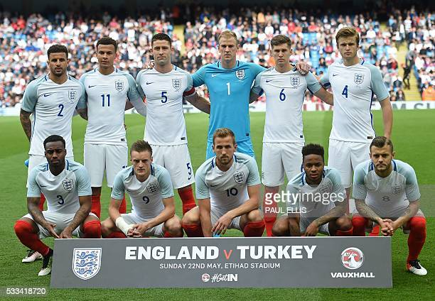 England players pose for a photograph England's defender Kyle Walker England's midfielder Dele Alli England's defender Gary Cahill England's...
