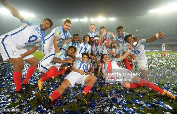 England players pose with the trophy after winning the FIFA U17 World Cup India 2017 Final match between England and Spain at Vivekananda Yuba...