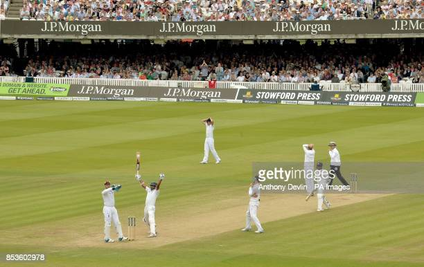 England players reacts as Sri Lanka's Kumar Sangakkara celebrates scoring his first century at Lord's during day three of the Investec Test match at...