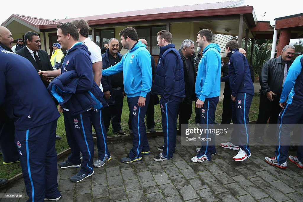 England players shake hands with local residents during the Maori traditonal welcome as they vist the Te iti o Haua Marae by the England Rugby Team on June 21, 2014 in Hamilton, New Zealand.