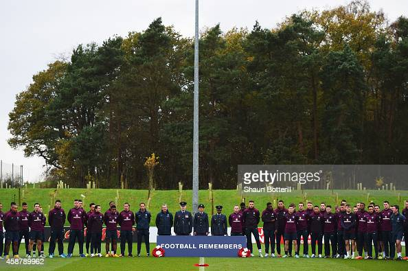 England players staff and members of the Armed Forces observe an Armistice Day silence during an England training session ahead of the UEFA European...