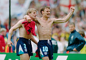 England players Stuart Pearce and Teddy Sheringham celebrate after the 1996 European Championships quarter final match victory against Spain at...