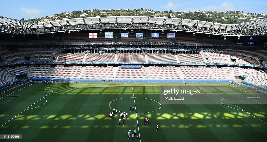 England players walk around in the stadium in Nice on June 26, 2016 during the Euro 2016 football tournament. / AFP / PAUL