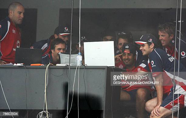 England players watch a laptop screen sitting in the dressing room after play on the fourth day of the third and final Test match between Sri Lanka...