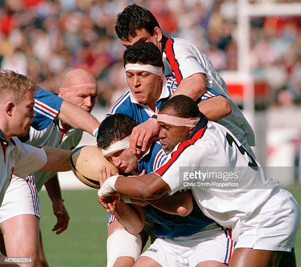 England prop forward Victor Ubobu grapples with French hooker JeanMichel Gonzalez who has Olivier Roumat in support during the Rugby Union...
